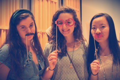 Culinarians enjoy photo props for maximum fun times! Left, Isabel Genecin (editor) and right, Amy Fu (business director)
